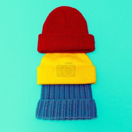 Set Stylish knitted cap on blue background