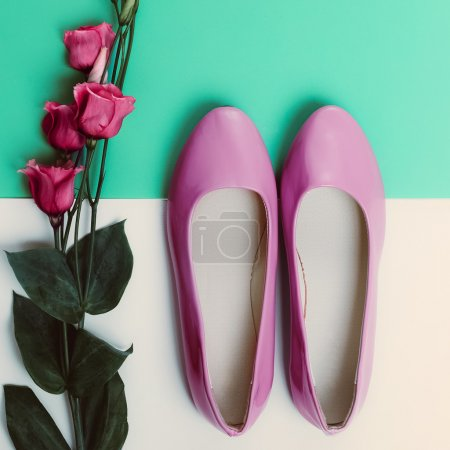 Ladies shoes and flower. Romantic fashion style.