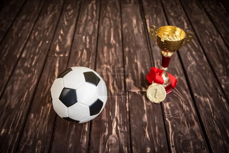 Ball, trophy and medal
