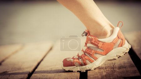 Feet of jogging woman