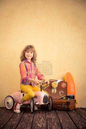 Child riding toy car