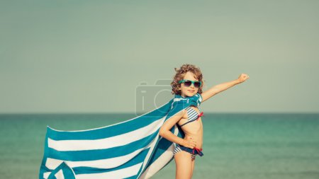Child having fun on the beach