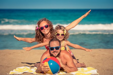 Photo for Happy family having fun on the beach. Summer vacation and travel concept - Royalty Free Image