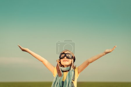 Photo for Happy child playing with toy airplane outdoors. Kid having fun against summer sky background. Travel and imagination concept - Royalty Free Image