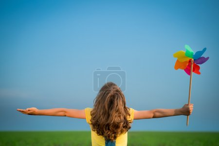 Photo for Happy child playing outdoors in summer field. Ecology concept - Royalty Free Image