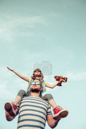 Kid and father playing outdoors