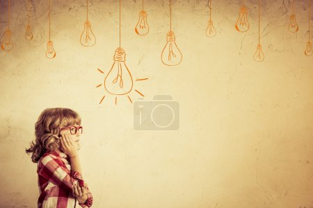Photo for Hipster kid thinking. Idea concept. Drawing bulb lump. Retro toned - Royalty Free Image
