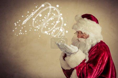 Photo for Santa Claus senior man against grunge background. Xmas holiday concept - Royalty Free Image