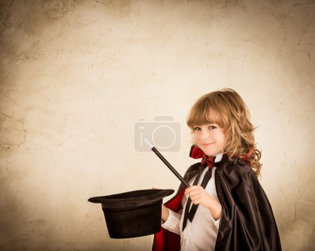 Photo for Child magician holding top hat and magic wand. Success concept - Royalty Free Image