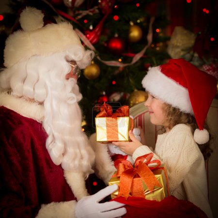 Photo for Santa Claus and child at home. Christmas gift. Family holiday concept - Royalty Free Image