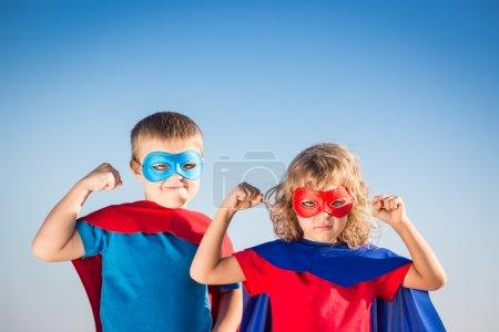 Superhero children having fun