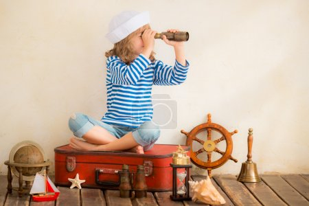 Child playing with  nautical things