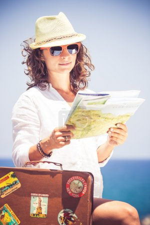 Photo for Young woman with vintage suitcase on summer vacation. Travel and adventure concept - Royalty Free Image