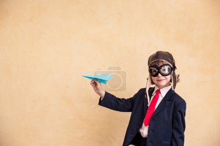 young businessman with paper airplane