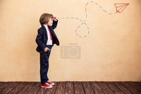 young businessman with drawn airplane