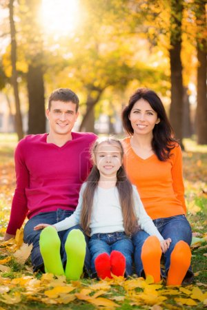 Photo for Happy family having fun outdoors in autumn park - Royalty Free Image