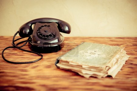 Retro phone and old book