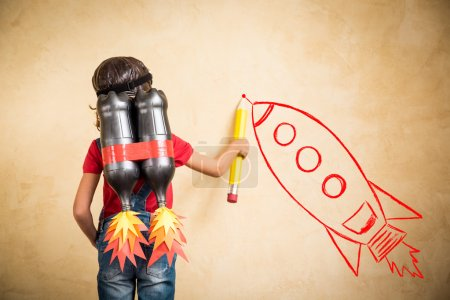 Photo for Kid with jet pack draw sketch on wall. Child playing at home. Success, leader and winner concept - Royalty Free Image