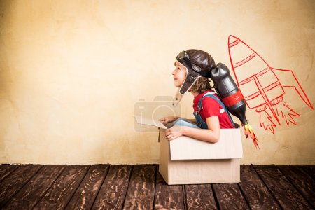 Photo for Kid with jet pack. Child playing at home. Success, leader and winner concept - Royalty Free Image