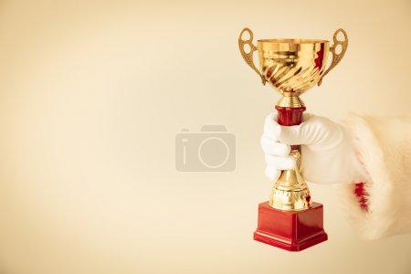 Santa Claus holding trophy