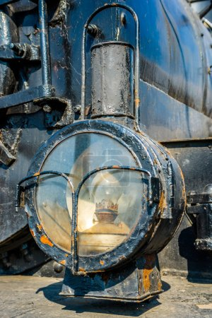Closeup view of a headlight of the ancient steam locomotive. Pet