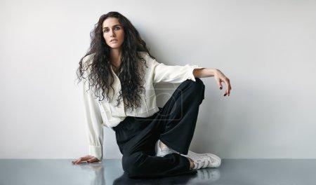 fashion woman sitting on the floor