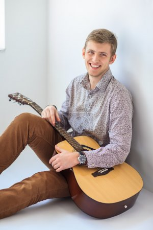 handsome smiling man with guitar