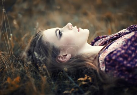 Photo for Portrait of beautiful hippie girl lying on the grass - Royalty Free Image