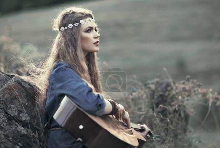 Beautiful hippie girl with guitar