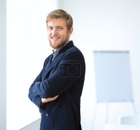 Photo for Portrait of young successful businessman in office. Crossed arms - Royalty Free Image