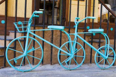 Blue double bike near cafe in Kharkov, Ukraine...