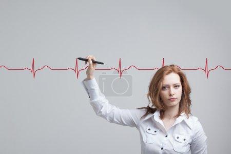 doctor woman drawing cardiogram