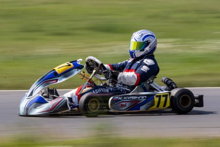 Photo for Unidentified pilot compete on the Atron track in the Rotax max Cup RAF series of sports karting, track race - Royalty Free Image