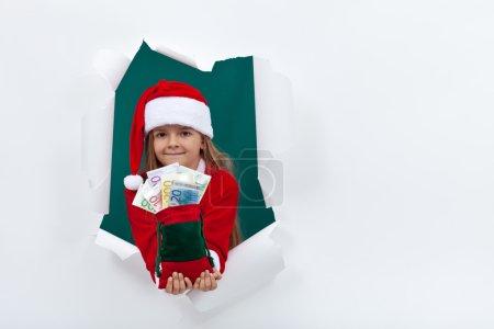 Little santa giving you money for the holiday season