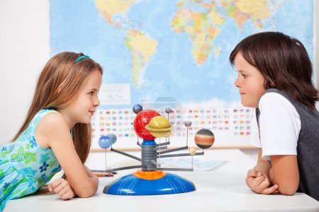 Kids with a scale model planetary system in science class