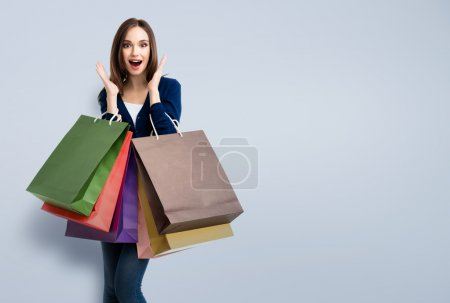 Photo for Very happy beautiful young woman in casual clothing with shopping bags, with copyspace for slogan or text message - Royalty Free Image