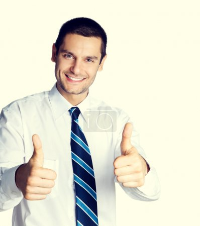 businessman showing thumbs up hand sign gesture