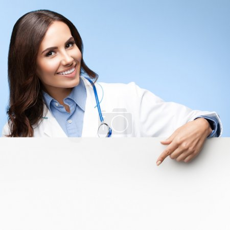 doctor showing blank signboard with copyspace