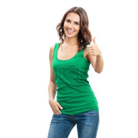 Foto de Retrato de cuerpo entero de feliz sonriendo hermosa mujer joven mostrando pulgares arriba gesto, en verde ropa casual, aislada sobre fondo blanco - Imagen libre de derechos