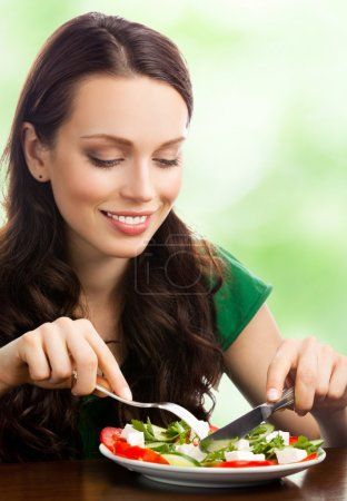 Photo for Young happy smiling woman with fegetarian salad, outdoor - Royalty Free Image