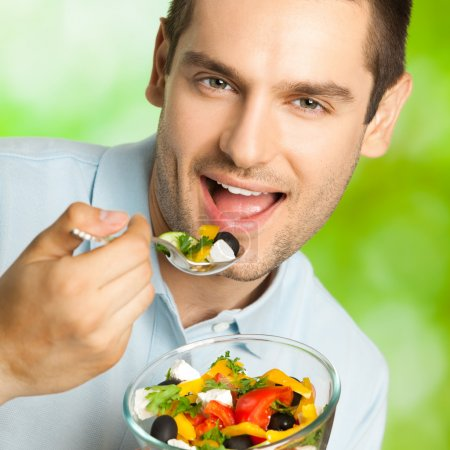 Photo for Portrait of cheerful smiling man with salad, outdoor - Royalty Free Image