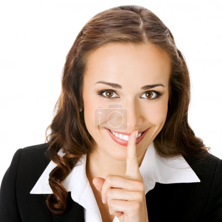 Businesswoman keeping finger on lips, isolated