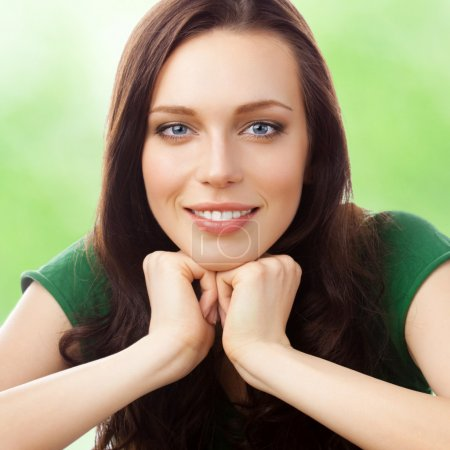 Portrait of cheerful smiling beautiful young woman...