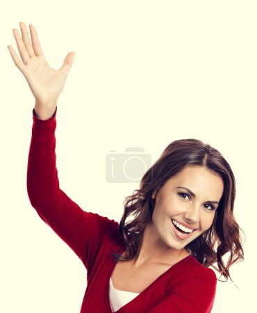 Happy gesturing young woman