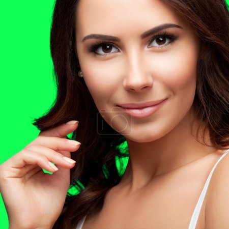Portrait of smiling young beautiful woman, on green chroma key b