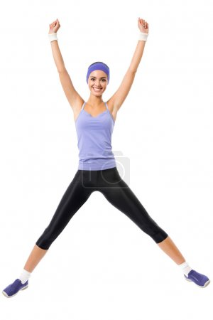 happy smiling woman jumping or doing fitness aerobics exercise,