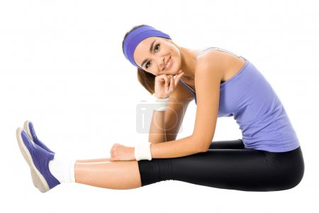woman in violet sportswear doing fitness stretching exercise or