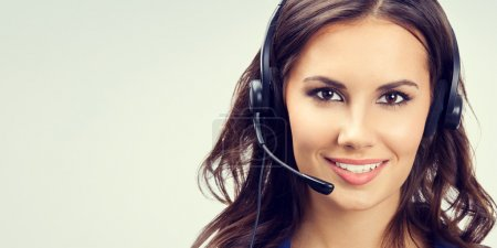 Cheerful smiling young support phone operator