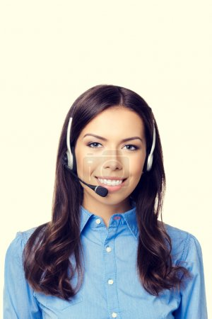Cheerful customer support phone operator, with copyspace