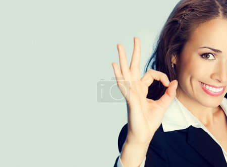 Happy businesswoman with okay gesture